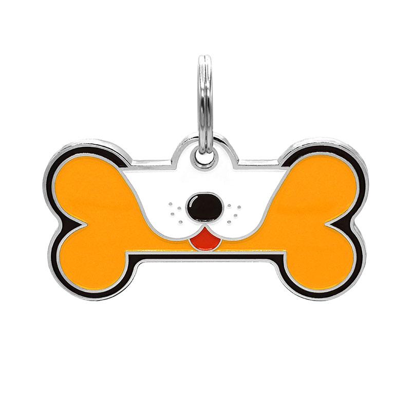 Dog ID tag with tongue out on orange yellow dog bone