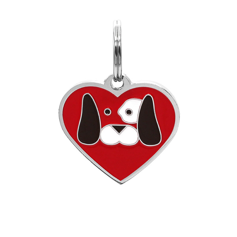 Dog tag heart shaped with dog face on red background