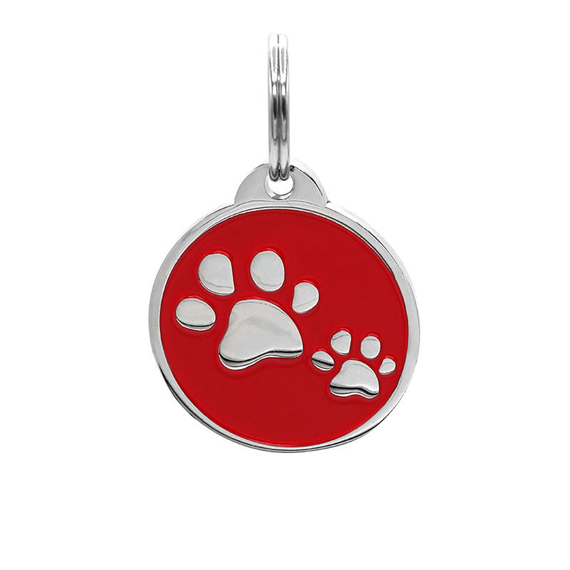 Pet ID tag with two pet paws on red background