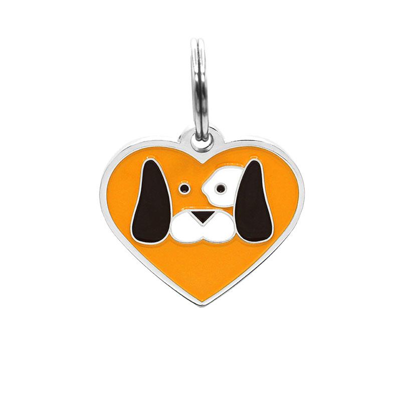 Dog tag heart shaped with dog face on orange background
